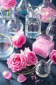 picture of flask  - alchemy and aromatherapy with rose flowers and chemical flasks - JPG