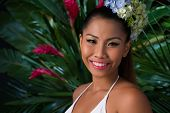 stock photo of filipina  - Young girl in tropical forest smiling and looking at the camera - JPG