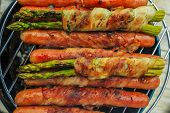 foto of grilled sausage  - Grilled sausages and asparagus with bacon - JPG