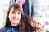 pic of hair blowing  - Hairdresser blow dry woman hair in shop - JPG