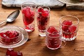 pic of sorrel  - Preparation of frozen hibiscus tea also known as karkade agua fresca or red sorrel on a wooden table - JPG