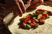 stock photo of shawarma  - Cooking traditional shawarma wrap with chicken and vegetables - JPG