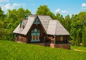 stock photo of house woods  - Beautiful wooden house in the Russian style in the woods - JPG