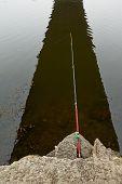 foto of fishing rod  - Fishing rod over the water - JPG