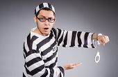 picture of prison uniform  - Funny prisoner in handcuffs isolated on gray - JPG