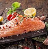 pic of salmon steak  - Delicious salmon steak on stone table - JPG