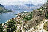 image of marina  - View of the roofs of the houses and the marina with a fortress wall in the old town of Kotor Montenegro - JPG
