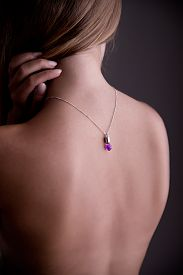 stock photo of nacked  - Back side portrait of a nacked woman with a necklace - JPG