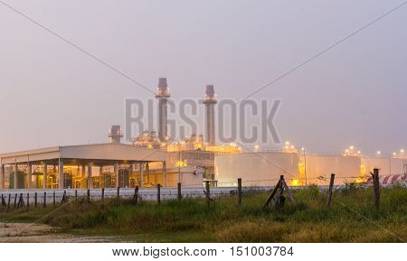 Oil refinery power station at sunrise in Thailand