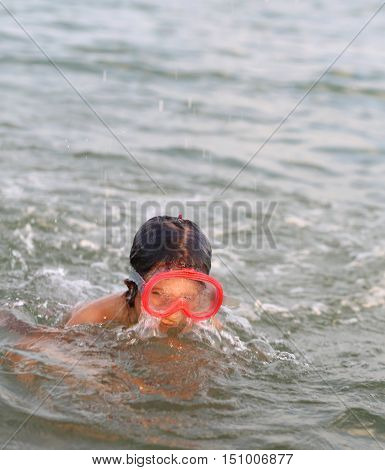 Little Girl Smiling While Playing With The Mask Diving Under Wat