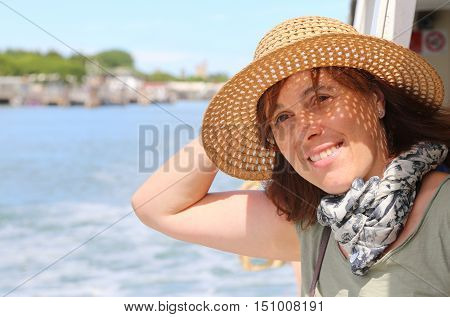 Cute Forty Year Old Woman With Straw Hat