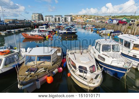 West Bay harbour Dorset uk with boats on a beautiful day with blue sky in summer