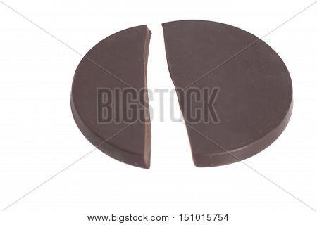 Broken round chocolate bar isolated on white background
