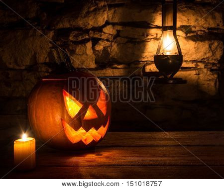 halloween pumpkin on wooden table in basement