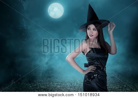 Portrait Of A Beautiful Woman With The Hat And Witch Corset