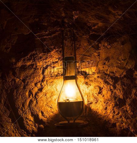 kerosene lamp in cellar. halloween background or wallpaper