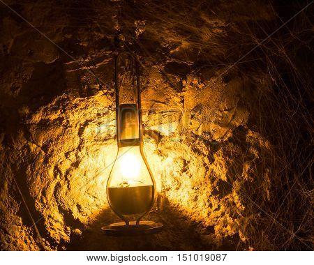 kerosene lamp in cellar. halloween background or wallpaper