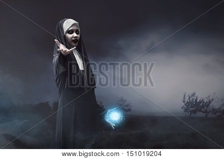 Devil Asian Nun With Blue Spell Power In His Hand