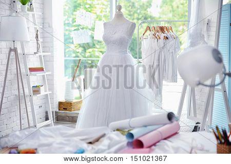 Made-up wedding dress on mannequin in wedding designer studio