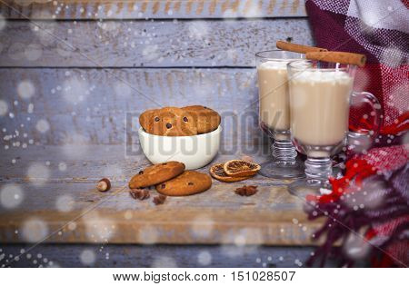 Hot cacao with marshmallows and cookies with chocolate and nuts on a gray wooden background