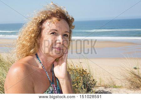 Close-up Of Blond Woman Wearing A Dress Thoughtful