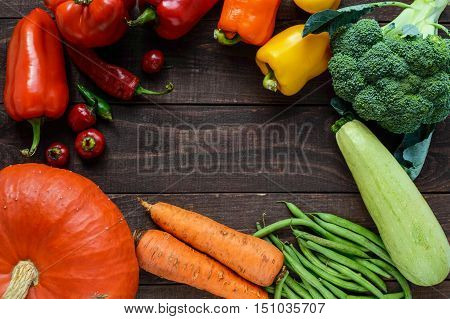 Set of vegetables (broccoli carrots green beans squash sweet pepper chili zucchini) for the preparation of healthy meals. The top view