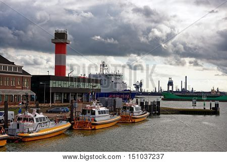 White and yellow pilot boat in Rotterdam shipyard