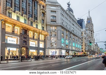 Madrid Spain - January 3 2016: Gran Via Street in Madrid at dusk. It is the most important commercial street in Madrid.