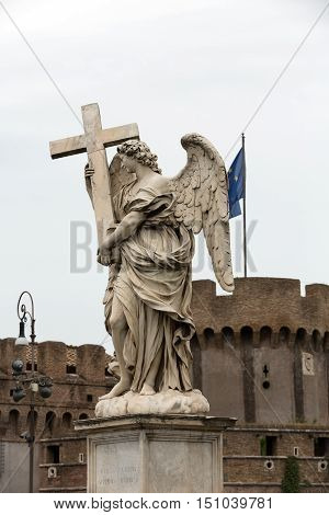 Marble statue of Angel with the Cross by Ercole Ferrata from the Sant'Angelo Bridge in Rome Italy