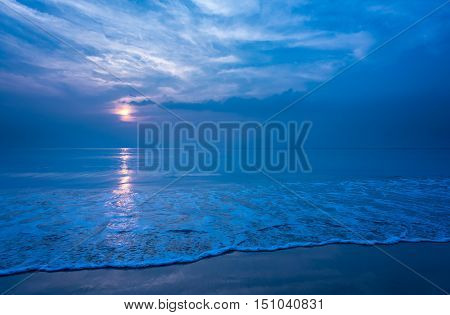 Beautiful secluded beach and smooth foam wave at night Copy space.
