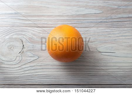 Perfect round fresh ripe grapefruit over white natural aged wooden background
