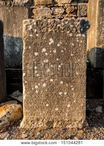 SELCUK IZMIR TURKEY - SEPTEMBER 13 2016: Inscription stone in Ephesus was an ancient Greek city on the coast of Ionia. UNESCO World Heritage Site.
