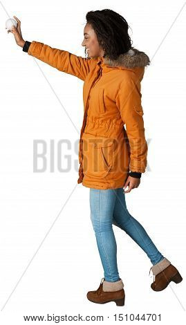 Portrait of a Woman with Winter Jacket Throwing Snowball