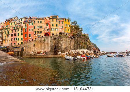 Riomaggiore fishing village in Five lands, Cinque Terre National Park in the evening, Liguria, Italy.