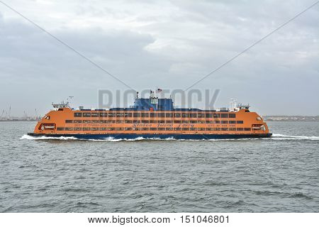 NEW YORK CITY USA - OCTOBER 15 2014: Staten Island Ferry departs for Manhattan. The ferry carries over 21 million passengers a year