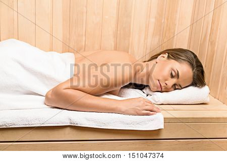 Closeup of a Woman Lying Down in the Sauna