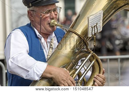 TIMISOARA ROMANIA - SEPTEMBER 25 2016: Old singer ethnic German from Banat Romania playing at trombone with occasion of Festival of ethnic groups