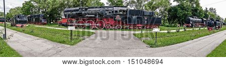 RESITA ROMANIA - JUNE 21 2016: Panoramic view of the steam locomotive park in Resita Romania.