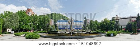 RESITA ROMANIA - JUNE 20 2016: Panoramic view with Kinetic fountain located in the central square of Resita and sports hall. Creation of sculptor Constantin Lucaci was inaugurated on 23 August 1984