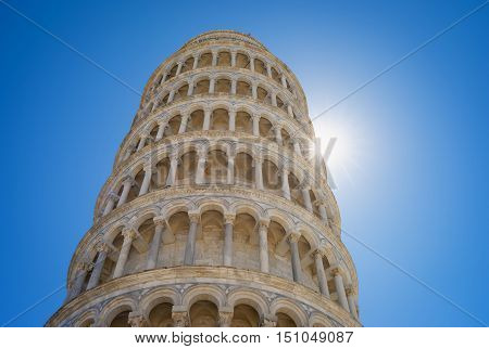 Detail of the world famous Pisa Tower, taken with a summer sun backlight rays.