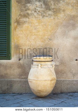 View of a typical etruscan earthenware jar in Populonia (Tuscany, Italy), ancient village along the shores of the Tyrrhenian Sea (knew as Etrurian Coastline), used as a street decoration.