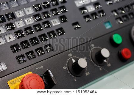 Control panel of modern CNC machine. Selective focus.