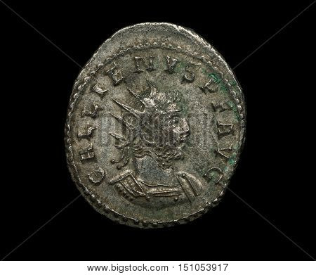 Ancient Silver Roman Coin Of Emperor Gallienus Isolated On Black