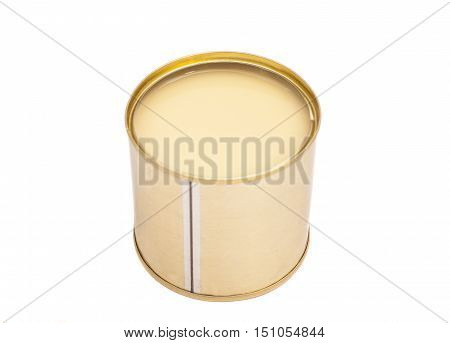 Condensed milk in tin can over white background