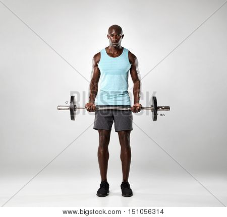 African Male Exercising With Barbell
