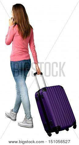 Portrait of a Woman Carrying Luggage while Talking on the Phone