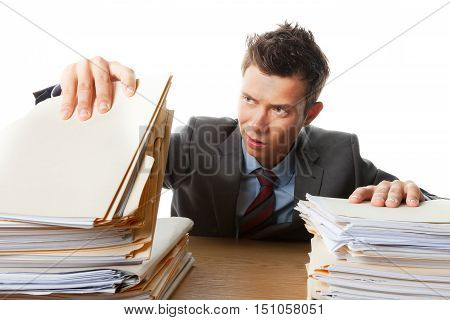 Portrait of an Unhappy Employee with Stack of Documents