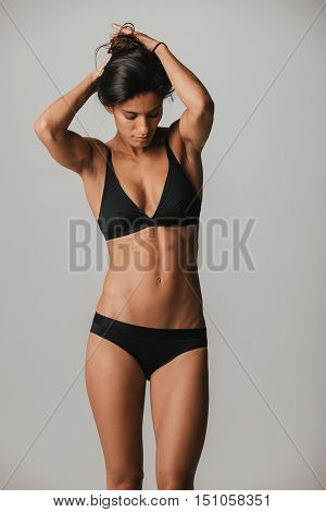 Strong Athletic Tan Woman In Black Under Garments