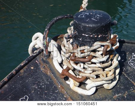 a strong rusty chain in a port