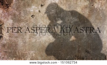 Per Aspera Ad Astra. A Latin phrase meaning Through hardships to the stars
